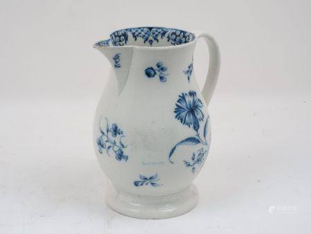 A Liverpool porcelain blue and white jug of baluster form, decorated with floral sprays to body