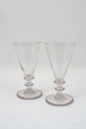 A pair of George III ale glasses, with conical bowls and knopped stems, each 19.5cm high (2)Please