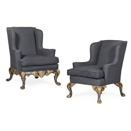 TWO GEORGE II STYLE EBONISED MAHOGANY AND PARCEL GILT WING ARMCHAIRS LATE 19TH/ EARLY 20TH CENTURY