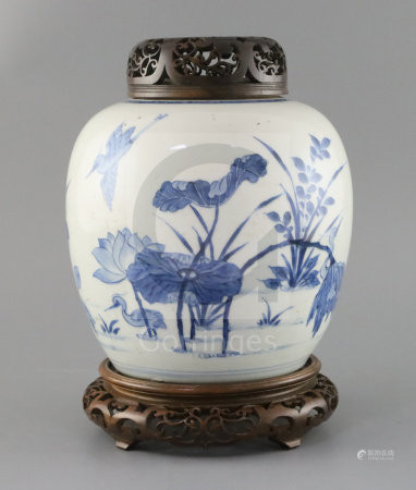 A Chinese blue and white ovoid jar, Kangxi period, painted with egrets amid a lotus pond, double