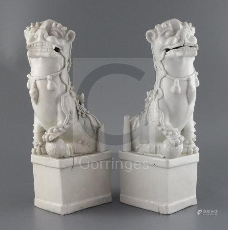A pair of large Chinese blanc de chine Buddhist Lion joss stick holders, Dehua, Kangxi period, H.