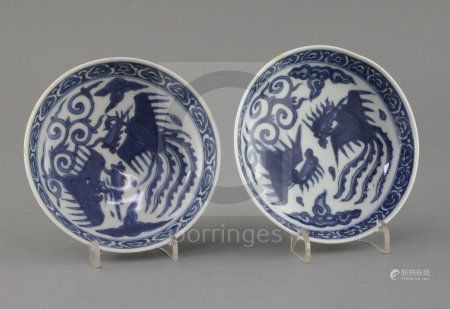 A pair of Chinese Ming blue and white 'phoenix' saucer dishes, pseudo Wanli mark, 17th century,