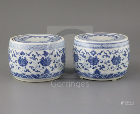 A pair of Chinese blue and white jars and covers, Yongzheng marks but later, each painted with lotus
