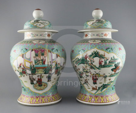 A pair of Chinese famille rose jars and covers, late 19th century, each painted with panels of