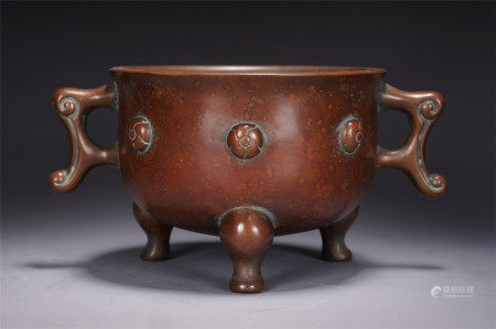 A CHINESE BRONZE TRIPLE FEET DOUBLE HANDLE CENSER