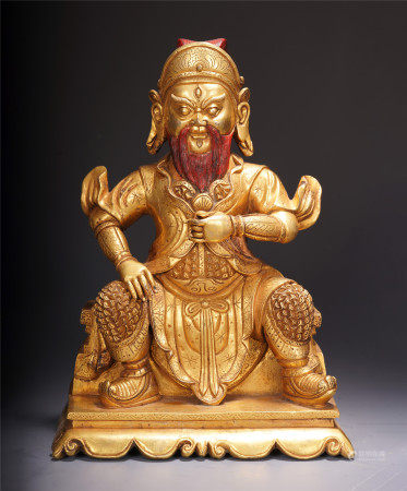 A CHINESE GILT BRONZE WARRIOR SEATED STATUE