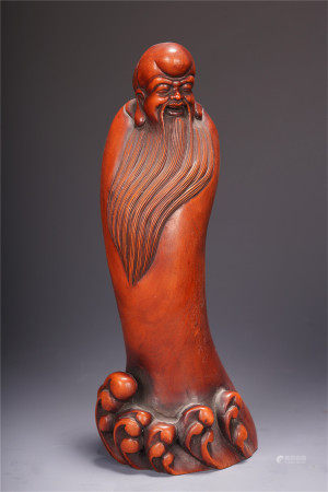 A CHINESE BOXWOOD LOHAN STANDING STATUE TABLE ITEM