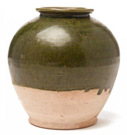 A SMALL DARK GREEN-GLAZED POTTERY JAR