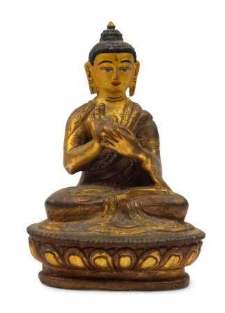 A Tibetan gilt bronze seated Buddha statue, 18th/19th centur