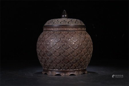 A Chinese Carved Hardwood Jar with Cover