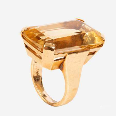 A large 14k gold and yellow quartz ring.
