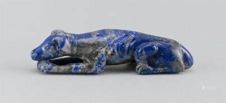 CHINESE LAPIS LAZULI CARVING OF A RECLINING DOG Rich blue co