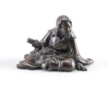 CHINESE BRONZE SCROLL WEIGHT In the form of a seated sage ho