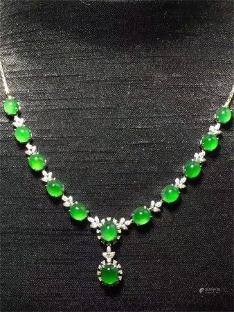 A Chinese Carved Jadeite Necklace