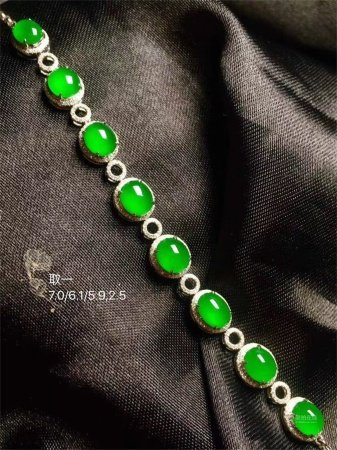 A Chinese Carved Jadeite Bracelet