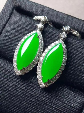 A Pair of Chinese Carved Jadeite Earrings