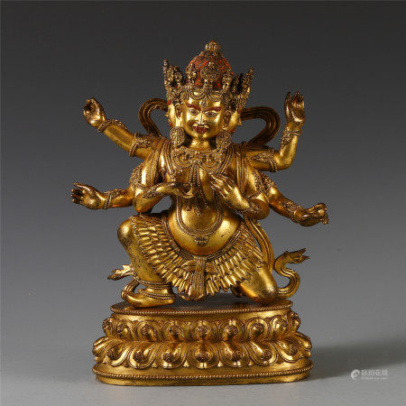 CHINESE BRONZE GILT OF TRIPLE FACE BUDDHIST GUARDIAN STATUE