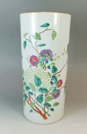 A 19th century Chinese famille rose cylindrical vase painted flowers and birds,