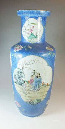 A Chinese late 19th century baluster vase with blue ground decorated reserves painted garden