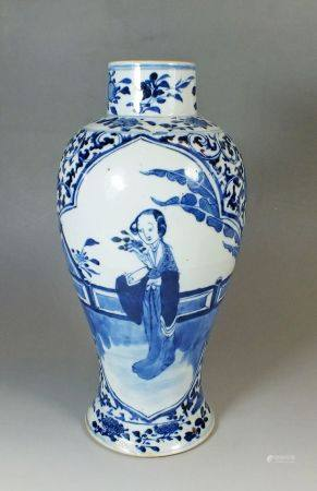 A Chinese Kang Hsi blue and white baluster vase painted figure of a women with flowers, 26cm
