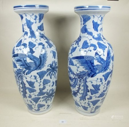 A pair of large Chinese reproduction vases decoration dragons and leaves 60cm