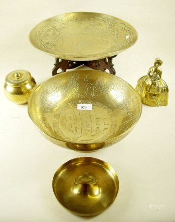An oriental brass dish on wooden stand and other brassware