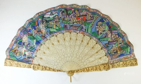 A 19th century Chinese Canton carved ivory and painted fan - the ivory carved with figures of