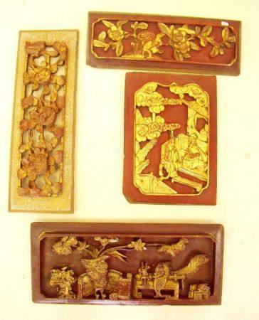 Four carved Chinese gilt and lacquer panels, largest being 39 x 18cm