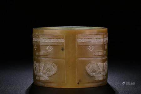 A CARVED JADE CONG.