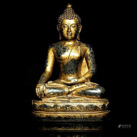 A very large gilt-bronze seated figure of Buddha