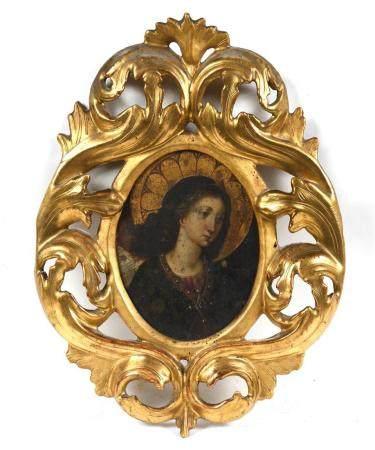 École française XIXe.Sainte à l'auréole.Huile sur panneau ovale présentée dans un cadre feuilla