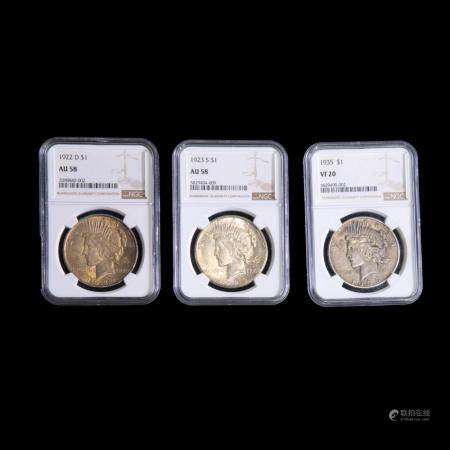 Three Peace Silver Dollars, NGC Rated. 90% Silver