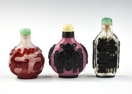 Three Chinese Overlay Glassware Snuff Bottles