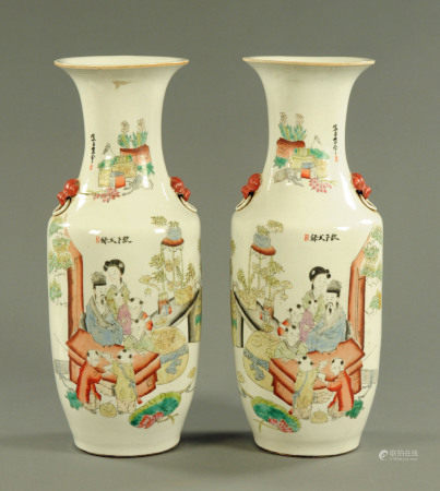 A large pair of Chinese polychrome vases, with numerous character marks and figures. Height 60 cm.