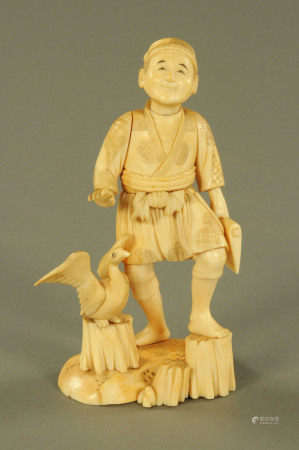 A late 19th/early 20th century Japanese carved ivory figure of a wood cutter and goose,