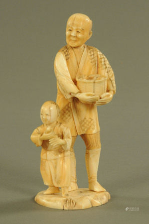 A late 19th/early 20th century Japanese carved ivory figure group, farmer and son, signed to base.