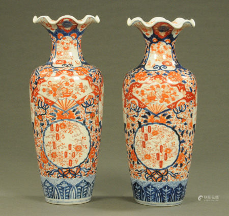 A pair of Japanese Imari baluster vases, decorated in typical Imari palette.