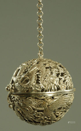 A Chinese white metal incense ball,