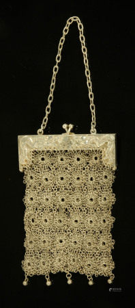A Chinese silver mesh purse, the clasp with opposing dragons and character mark to one side,