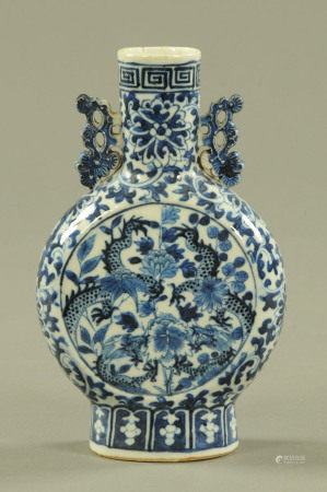 A 19th century Chinese moon flask, decorated with dragons. Height 21 cm.