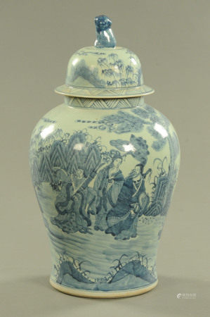 An Oriental lidded vase, blue and white decorated with figures in landscape.