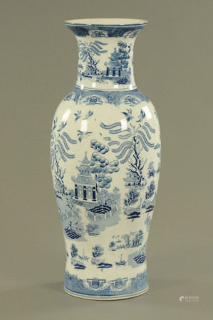 A Chinese porcelain blue and white printed willow patterned vase, height 60 cm.