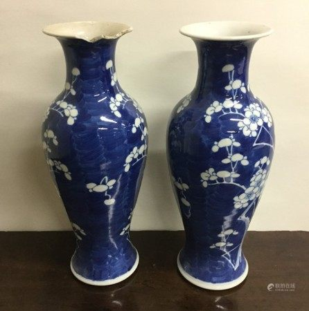 A tall pair of Chinese blue and white baluster sha