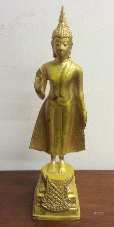 A tall metal figure of a Thai lady wearing Makuta.