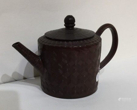 An early terracotta Chinese teapot with textured b