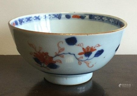 A Chinese circular bowl decorated with flowers. Ap