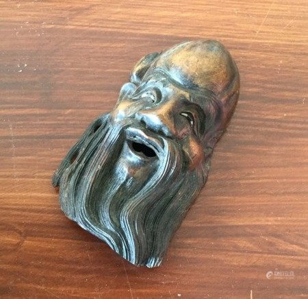 A Chinese root wood wall mount in the form of a he