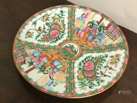 A circular Canton plate decorated in bright colour
