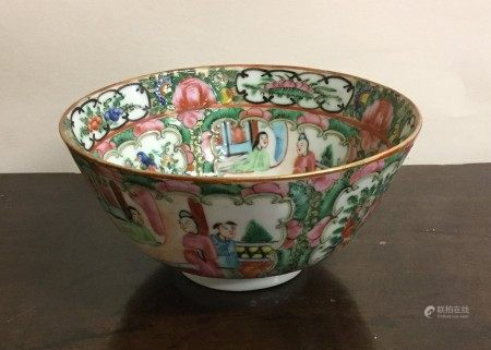 A Canton tea bowl decorated in bright colours. App