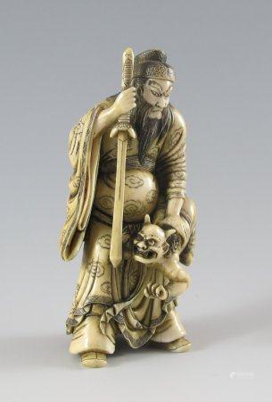 Shoki zeigt einem Oni das Schwert.